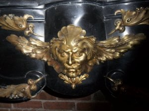 Close up of the mantel's bronze details