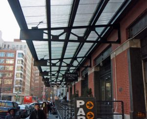 This canopy has been created with salvaged corrugated chicken-wire glass. Since glass is not bio-degradable, this is an excellent use for such an abundant material.