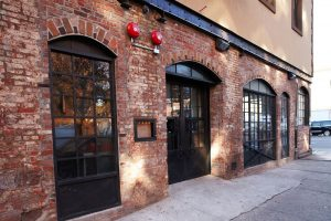 The delicious brick exterior and reclaimed chicken wire glass in the doors and windows of the restaurant are two of its great vintage features