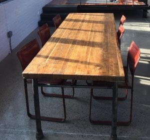 Reclaimed butcher block table with pipe legs