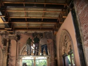The architecturologists are seen here dismantling one of the cast stone arches