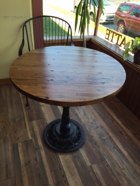 30 in. Wide bistro table made with the industrial flooring wood