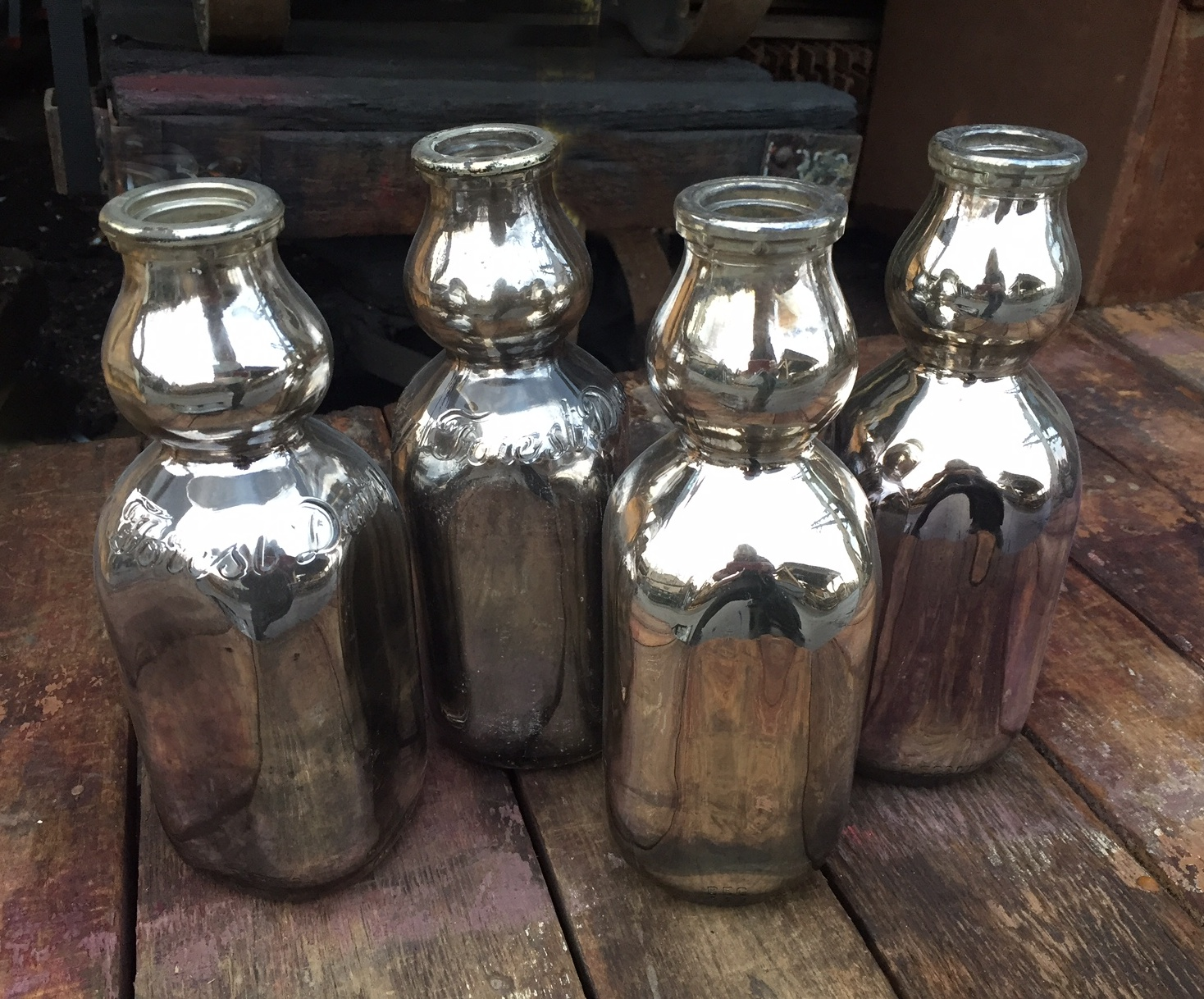 Hand silvered 1950s milk jugs
