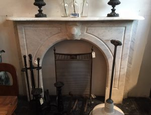 Simple Victorian arched marble mantel from early 1900's