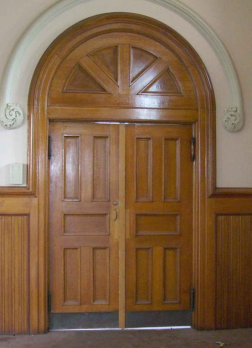 Quatersawn oak double entry doors with fan light transom for 12 light entry door