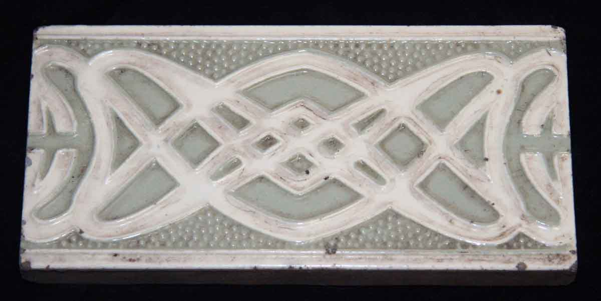 Green Tile with White Pattern