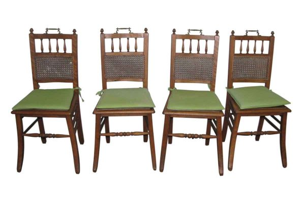 Set of Four Wooden Chairs with Ornate Hardware