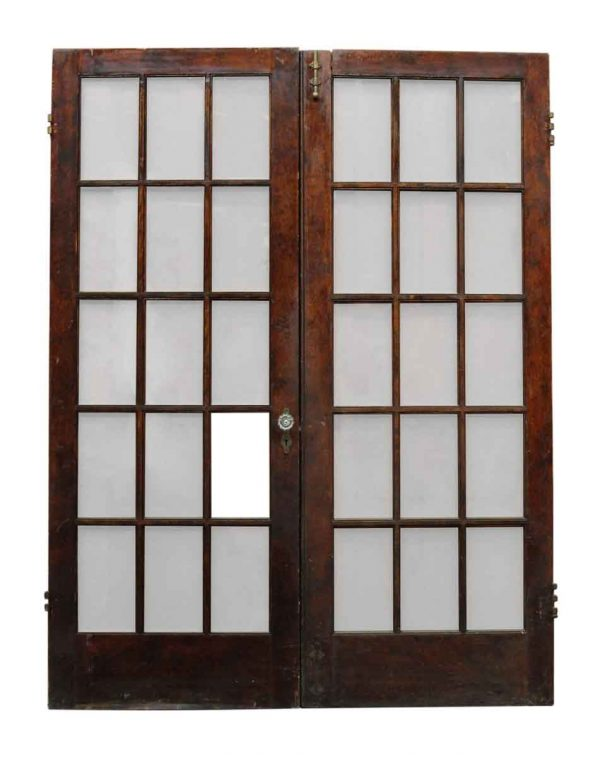 Pair of Eighteen Glass Panel Doors