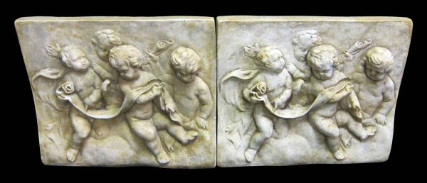 Set of Two Cast Cherub Reliefs in Composite