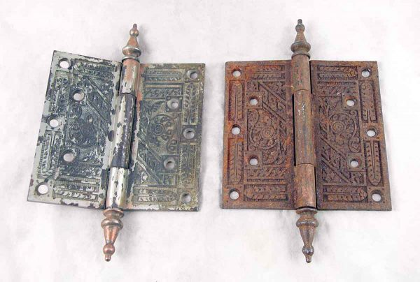 Set of two ornate cast iron door hinges with steeple tips