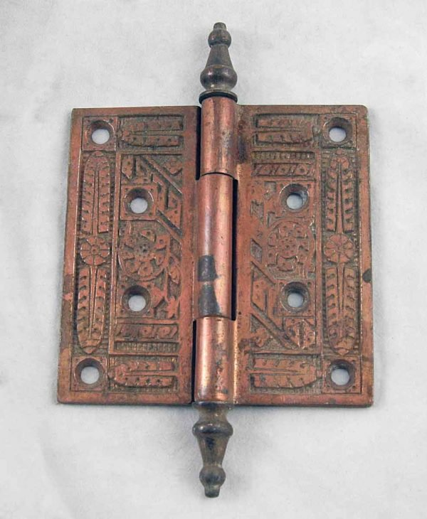 Set of three ornate door hinges with steeple tips