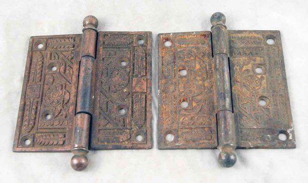 Set of two ornate door hinges with ball tips