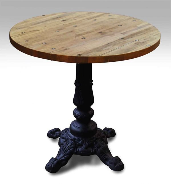 Round Industrial Floor Table with Black Four Footed Ornate Base