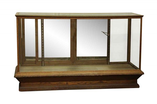 Commercial Furniture - Oak Floor Showcase with Mirrored Wavy Glass Back Doors