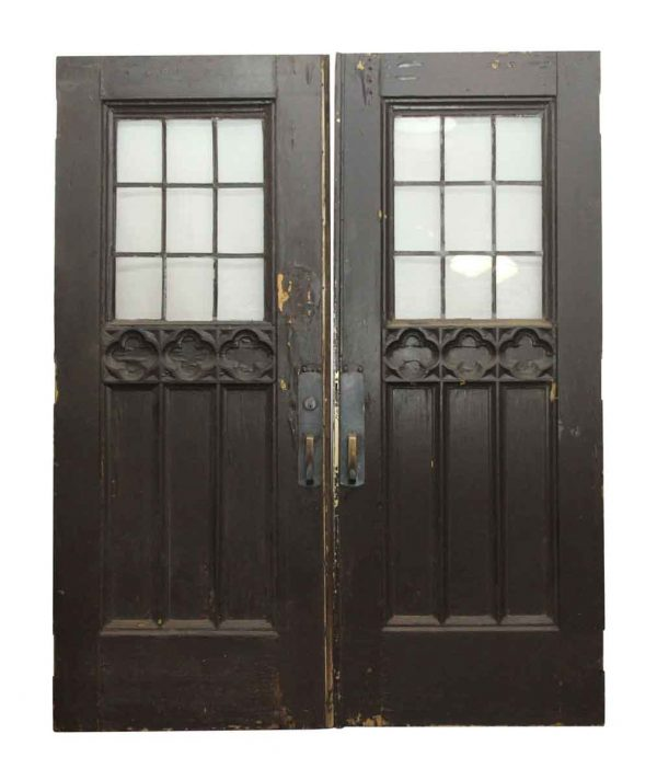 Entry Doors - Double Gothic Tudor Doors with Leaded Glass and Carved Detail