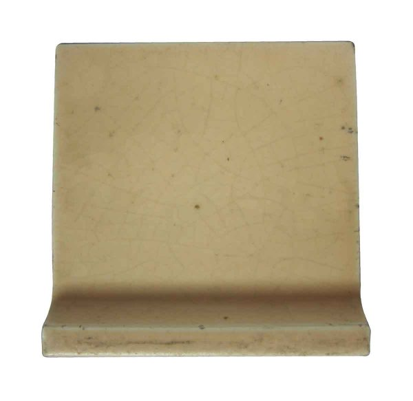 Bull Nose & Cap Tiles - Orange Peach Inside Curved 4.5 in. Square Baseboard Tile
