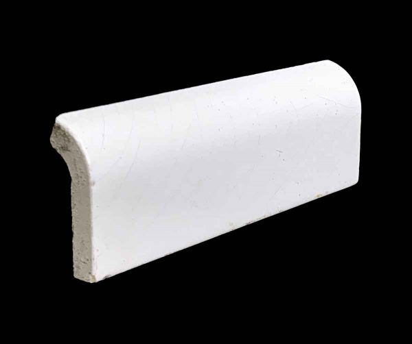 Bull Nose & Cap Tiles - 0.25 in. Thick White Crackled Outside Corner Cap Tile